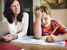 Mother Son Casual Bonding Activity Studying Concept Royalty Free Stock Photography