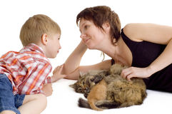 Mother and son with cat and kitten. Mother and son with cat and eating kitten isolated on white background Royalty Free Stock Photo