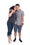 Mother and son. Caucasian mother kissing son on cheek in studio Stock Images