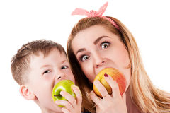 Mother son cheerfully biting apple Stock Photo