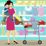Mother and son in children shop Stock Photo