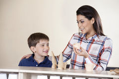 Mother And Son Choosing Between Cones  Cups Royalty Free Stock Photo