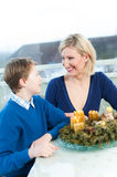 Mother and Son with Christmas Wreath stock photography