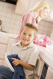 Mother And Son Cleaning Dishes Royalty Free Stock Photos