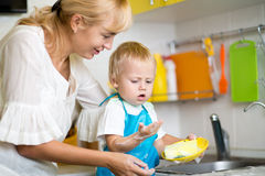 Mother And Son Cleaning Dishes Together Royalty Free Stock Images
