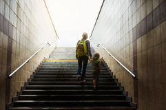 Mother and son climbing stairs Stock Image