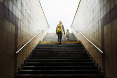 Mother and son climbing stairs Stock Images