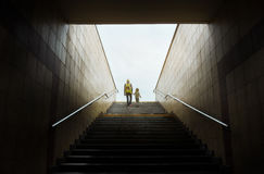 Mother and son climbing stairs Royalty Free Stock Image