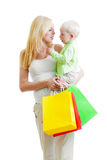 Mother with son and colorful paper shopping bags Royalty Free Stock Photo