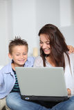 Mother and son with computer Stock Photos
