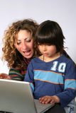 Mother and son at computer Royalty Free Stock Image