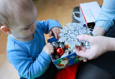 Mother and son consider Christmas decorations Stock Photo