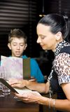 Mother And Son Consulting Menus Royalty Free Stock Images