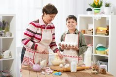 Mother and son cook at home. Healthy food concept Royalty Free Stock Photo