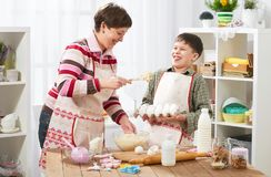 Mother and son cook at home. Healthy food concept Stock Image