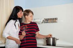 Mother son cooking Stock Photos