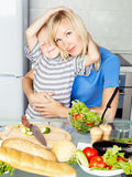 Mother and son cooking Stock Images