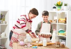 Mother and son cooking at home. Happy family. Healthy food concept Stock Images