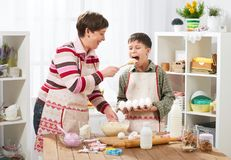 Mother and son cooking at home. Happy family. Healthy food concept stock photography