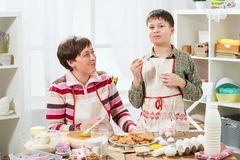 Mother and son cooking at home. Healthy food concept stock photos
