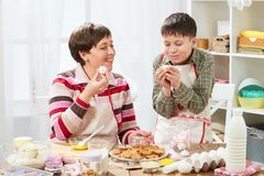 Mother and son cooking at home. Healthy food concept stock photography