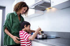 Mother and son cooking in kitchen. At home Stock Photography
