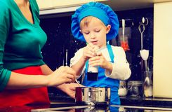Mother and son cooking in kitchen. Interior Stock Image