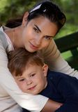 Mother and son cuddling outdoor Royalty Free Stock Photography