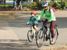 Mother and son cycling in the park Royalty Free Stock Images