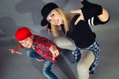 Mother and son dance hip-hop.Urban lifestyle. Hip-hop generation. Hip-hop generation.Mother and son dance hip-hop.Urban lifestyle royalty free stock image