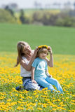 Mother and son in dandelion field Stock Photos