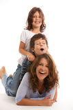 Mother with son and daughter. Mother, son and daughter lifestyle with a happy expression on a white background Stock Photos