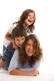 Mother with son and daughter. Mother, son and daughter lifestyle with a happy expression on a white background royalty free stock photos