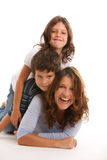 Mother with son and daughter. Mother, son and daughter lifestyle with a happy expression on a white background stock image