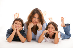 Mother with son and daughter. Mother, son and daughter lifestyle with a sad expression on a white background stock image