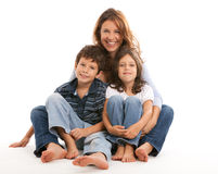Mother with son and daughter. Mother, son and daughter lifestyle with a happy expression on a white background stock images