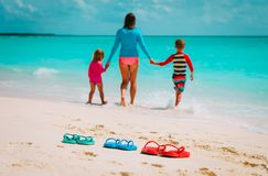 Mother with son and daughter on beach. Mother with son and daughter on tropical beach royalty free stock photography
