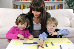 Mother, son and daughter drawing. At home Royalty Free Stock Photo