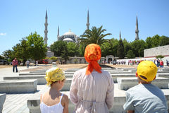 Mother, son and daughter going to the Sultanahmet Mosque Stock Photography