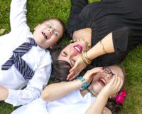 Mother, Son, and Daughter Lauging Outside in the Grass Royalty Free Stock Photo