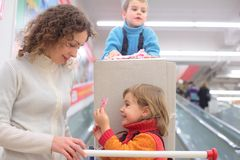 Mother with son and daughter in shop. Mother with son and daughter in modern shop Stock Photography