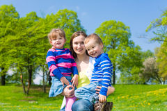 Mother with son and daughter on summer meadow Royalty Free Stock Photography