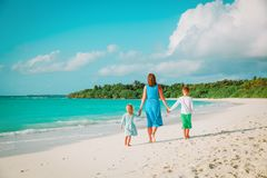 Mother with son and daughter walk on beach. Family beach vacation Royalty Free Stock Photography
