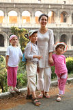 Mother, son and daughters are near Colosseum Royalty Free Stock Photos