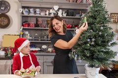 Mother and son decorating the christmas Stock Image