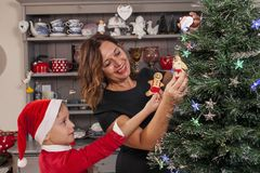 Mother and son decorating the christmas Stock Photography