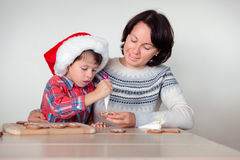 Mother and son decorating the gingerbread cookies Royalty Free Stock Photography