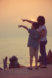 Mother and son in a deep moment of love during sunset at beach Royalty Free Stock Images
