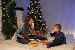 Mother and son dinner at Christmas Garland lights new year gifts. Mother and son dinner at Christmas Garland lights new year stock photos