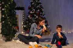 Mother and son dinner at Christmas Garland lights new year gifts. Mother and son dinner at Christmas Garland lights new year stock images